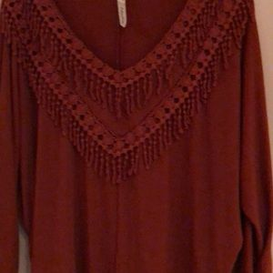 NWOT Rust color top with fringe